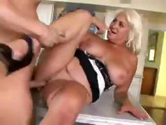 Busty blonde Danny Wylde sucks with an increment of gets fucked not far from the kitchenette