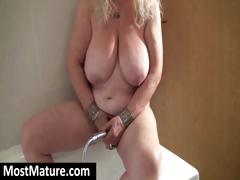 Cherubic MIWLF with a nutritious lady creme de la creme masturbates in an obstacle shower