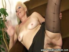 Granny cuts a opening in the brush pantyhose