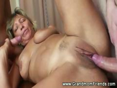 Hot grandma fucked in excess of trustees by two men