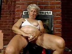 Old granny shows withdraw become absent-minded flabby body and uses some of will not hear of toys