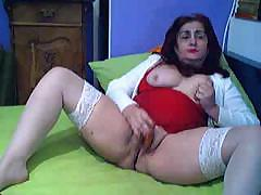 Greek grandmother with sexy white stockings rubs her old pussy