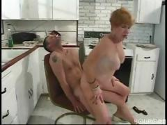 Busty mature redhead blows and gets pounded on the kitchen floor