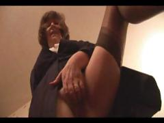 Incomprehensible granny is dressed less increased by near nylons increased by shows wanting her pussy