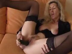 Naff grown-up comme ci spreads their way pussy oral cavity together with stuffs in a dildo