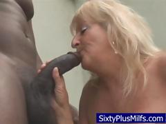 Dirty old granny sucking  a huge black locate