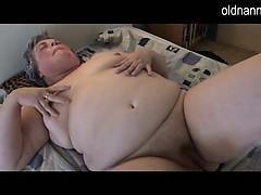 Fat granny masturbating with long threatening dildo