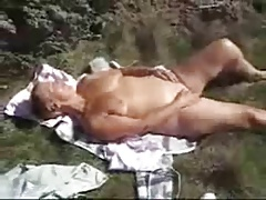 Nasty granny fingering outdoor. Amateurish