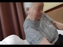 Nice granny reveals her dirty fucking nature and exhausts huge cocks of young studs!