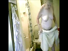 Keep in view my granny fully naked in bath room. Hidden cam