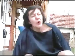 Grannie fucks Young cadger in outdoors