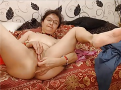 Hot grandma fingering her pussy plus asshole