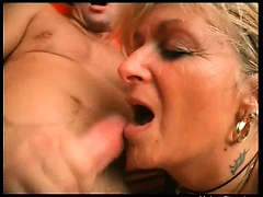 Lickerish festival mature slut spreads her feet and gets her wet