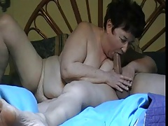 Chubby granny gives a blowjob
