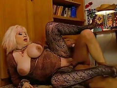 Slutty Granny Zhanna in stockings rewards voyeur with a fuck