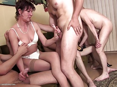 Mature mothers have group sexual intercourse with young boys