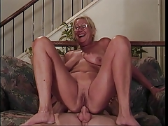 Mature fair-haired with glasses sucks a bushwa