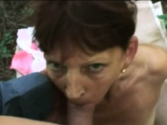Mature trull slobs a young knob outdoors